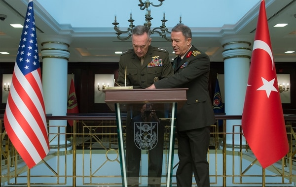 U.S. Marine Gen. Joseph F. Dunford Jr., left, chairman of the Joint Chiefs of Staff, signs the guestbook of Turkish Gen. Hulusi Akar, right, chief of Turkish Armed Forces prior to an office call in Ankara, Turkey, Jan. 6, 2016. (DoD Photo by Navy Petty Officer 2nd Class Dominique A. Pineiro)