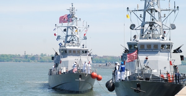 The patrol cruiser Hurricane in 2009 prepares to pull into the Stapleton Pier on Staten Island alongside sister Cyclone-class warship Tempest. (Navy)