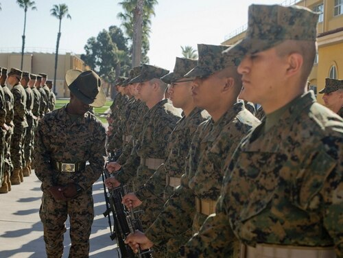 Sergeant Rashaud Drayton, drill instructor, Fox Company, 2nd Recruit Training Battalion, walks through a formation during a series commander inspection at Marine Corps Recruit Depot San Diego, March 1. (Lance Cpl. Jose Gonzalez/ Marine Corps)