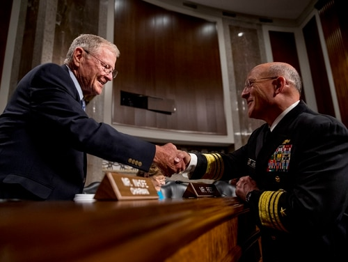 Senate Armed Services Committee Chairman Jim Inhofe, R-Okla., left, greets Vice Adm. Michael Gilday, right, at Gilday's confirmation hearing to be the next chief of naval operations on July 31, 2019. (Andrew Harnik/AP)