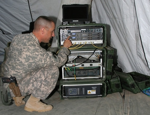 It can take a platoon of soldiers an entire day to build a command post, with its many hundreds of feet of cable and its complicated compilation of computer servers and terminals. (Amy Walker/Army)