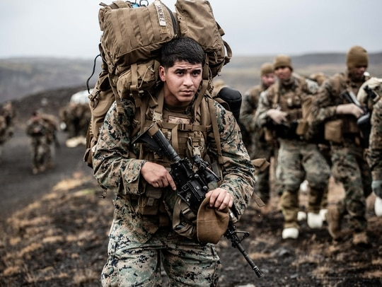 A Marine with the 24th Marine Expeditionary Unit carries cold weather equipment as he begins to march across the Icelandic terrain Oct. 19, 2018. (Capt. Kylee Ashton/Air Force)