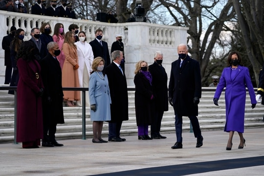 President Joe Biden and Vice President Kamala Harris arrive at the Tomb of the Unknown Soldier at Arlington National Cemetery during Inauguration Day ceremonies in Arlington, Va. Former President Barack Obama and his wife Michelle, former President George W. Bush and his wife Laura and former President Bill Clinton and his wife former Secretary of State Hillary Clinton and family look on. (Evan Vucci/AP)