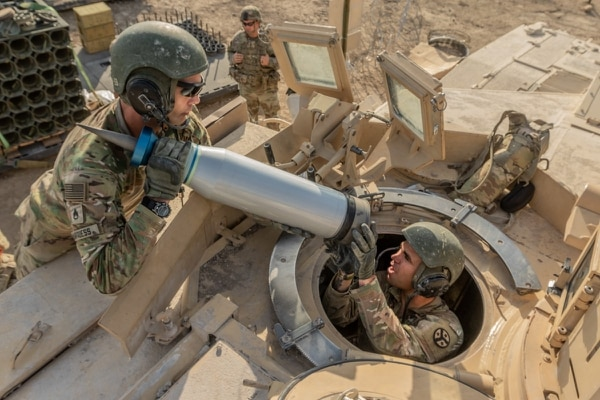 Armor crewmen assigned to Task Force Raider load Sabot rounds onto an M1 Abrams tank during a pre-deployment training exercise Aug. 18, 2018, at Fort Hood, Texas. (Sgt. Sarah Kirby/Army)