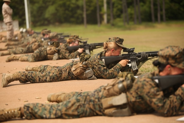 Recruits of November Company, 4th Recruit Training Battalion, fire during rifle marksmanship training May 28, 2014, on Parris Island, S.C. The recruits fired more than 200 rounds each over five days. At the end of the week, they attempted to qualify by shooting from distances of 200, 300 and 500 yards. November Company is scheduled to graduate July 3, 2014. (Parris Island has been the site of Marine Corps recruit training since Nov. 1, 1915. Today, approximately 20,000 recruits come to Parris Island annually for the chance to become United States Marines by enduring 13 weeks of rigorous, transformative training. Parris Island is home to entry-level enlisted training for 50 percent of males and 100 percent of females in the Marine Corps.Photo by Cpl. Octavia Davis)