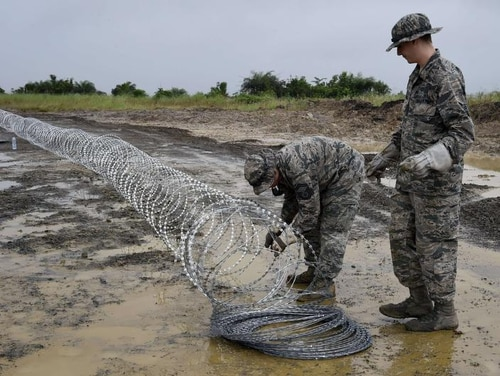US air Force soldiers delimit with barbed wire the position of the next Ebola treatment center reserved for contaminated healthcare workers in Monrovia where the virus continues to claim more victims. Liberia is the country hit hardest by the largest Ebola outbreak on record, accounting for about two-thirds of the total 3,338 deaths recorded in the region since the beginning of the year. AFP PHOTO / PASCAL GUYOTPASCAL GUYOT/AFP/Getty Images