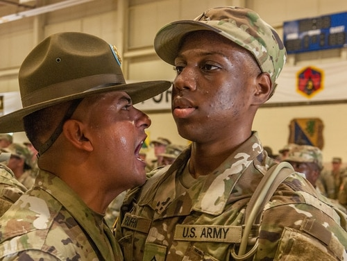 A drill sergeant with 2nd Battalion, 48th Infantry Regiment, welcomes a new soldier to Fort Leonard Wood, Mo. (Stephen Standifird/Army)