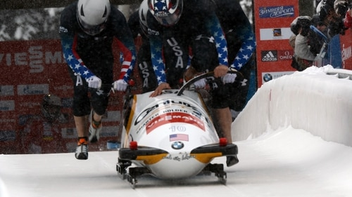 Sgt. Nick Cunningham of the U.S. Army World Class Athlete Program jumps into the sled to drive Olympic gold medalist and WCAP teammate Sgt. Justin Olsen, Johnny Quinn and Abraham Morlu to 16th place in the four-man bobsled event at the International Bobsled and Skeleton Federation's 2013 World Cup stop Dec. 7, 2013, at Utah Olympic Park in Park City, Utah. (Tim Hipps/Army)