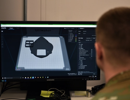 U.S. Air Force Tech. Sgt. Tracy Gibbs, 312th Training Squadron Special Instruments Training course graduate, prepares a 3D printed N95 face mask to be printed through modeling software at the Louis F Garland Department of Defense Fire Academy on Goodfellow Air Force Base, Texas, March 31, 2020. (U.S. Air Force photo by Airman 1st Class Robyn Hunsinger)