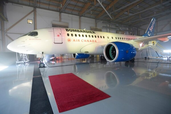 A Bombardier C Series jet sits in a Montreal hanger. The U.S Commerce Department slapped duties of nearly 220 percent on Canada's Bombardier C Series aircraft on Sept. 26, 2017, in a victory for Boeing. (Paul Chiasson/The Canadian Press via AP)