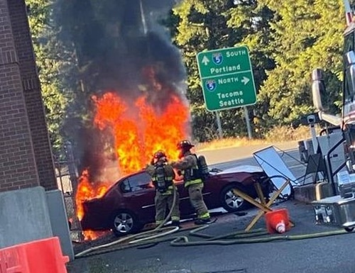 A driver was arrested July 18 after he ran his car into a gate at JBLM and the vehicle caught fire, base officials say. (Air Force amn/nco/snco photo).