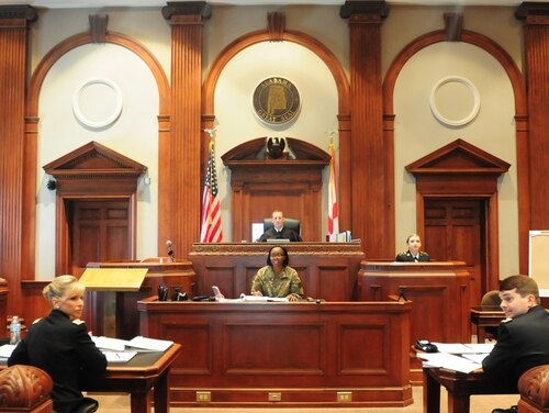 The 167th Theater Sustainment Command judge advocate general hosts a mock trial with members of the Alabama National Guard. Statistics show that men, and troops of black or Hispanic background, may be more likely to face trial than their counterparts. (Staff Sgt. Katherine Dowd/Army)