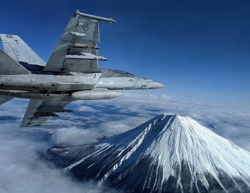 An F/A-18F Super Hornet conducts flight operations near Mount Fuji on Jan. 29, 2020, at Atsugi, Japan. (Lt. Alex Grammar/Navy)